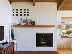 Fireplace and interior view of modern home in Portland, Oregon. Mid-Century design elements with period furniture.
