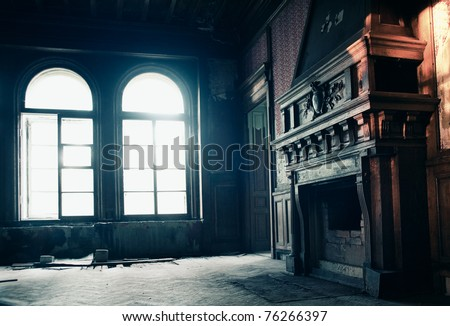 Fireplace at old ruins with magic light through windows