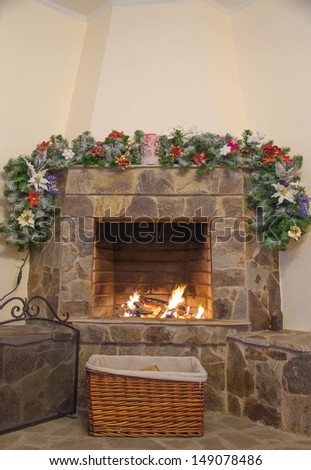 fireplace decorated with noel ornaments