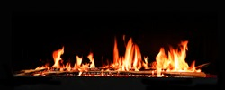 Fireplace fire in front of dark background for wintertime