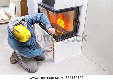 Fireplace installing. Fireplace made from Calcium Silicate Fire Protective Board.  #544152829