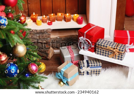Stock Photo Fireplace with beautiful Christmas decorations and gifts in room