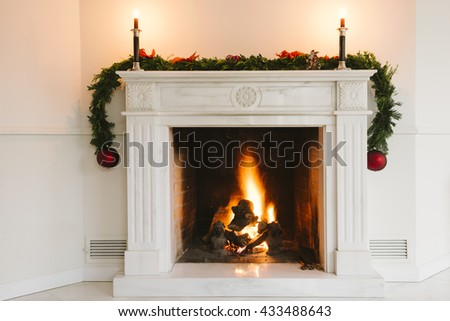 Fireplace with christmas decoration #433488643