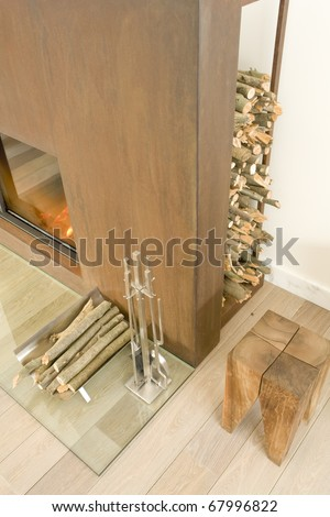 fireplace with tools and wood