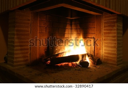 Fireplace wood fire in small villa in tuscany