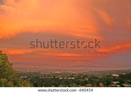 Fires reflected in sky over Los Angeles Basin - stock photo