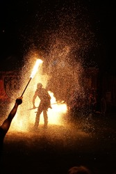 Fireshow in the dark at medieval festival