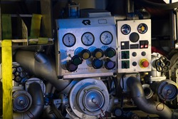 Firetruck pumping and valve control panel, firefighter car equipment of emergency vehicle, rescue service. Water pump controls details. Translation: ''High pressure''