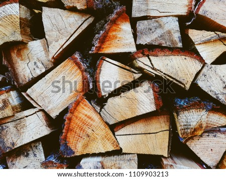 Firewood background, wall firewood, background of dry chopped firewood logs in a pile #1109903213