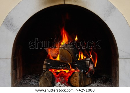 firewood burning at the fireplace close up