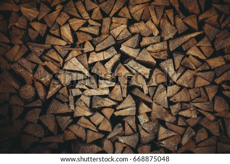 Firewood Dry firewood in a pile for furnace kindling #668875048