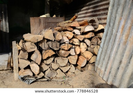Firewood is used in the winter and is used for cooking , fire wood #778846528