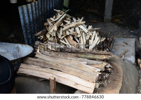 Firewood is used in the winter and is used for cooking , fire wood #778846630