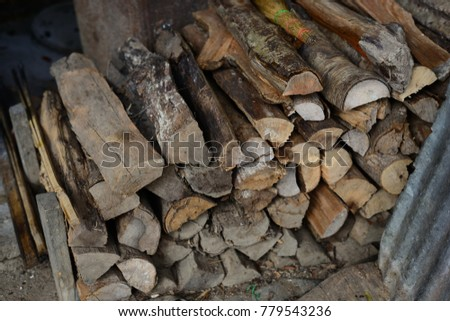 Firewood is used in the winter and is used for cooking , fire wood #779543236