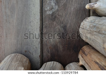 Firewood logs and wooden wall panels.