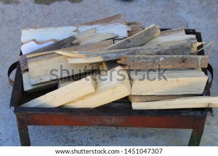Firewood ready to burn for grilling chicken Stok fotoğraf ©