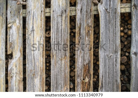 Firewood storage house, old building, gray boards, planks #1113340979