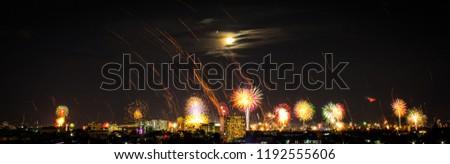Firework and sky lantern, Kongming lantern, Chinese lantern in New Year Celebration at night