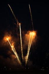 Firework burst in the sky during anniversary. Fiesta mood on.