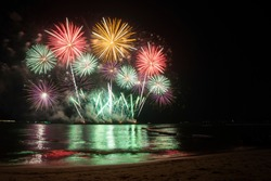 firework colorful in dark night with reflection at Pattaya beach
