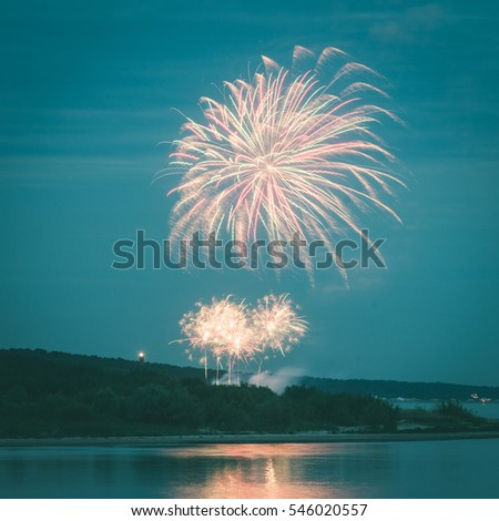 Firework festival on the Baltic seashore in the night - instant vintage square photo