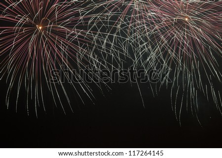 Firework streaks in the night sky,shanghai china - stock photo