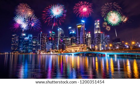 Firework with cityscape night light view of river side Singapore skyline at twilight time  #1200351454
