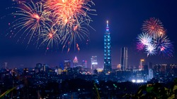 Firework with cityscape night light view of Taipei. Taiwan city skyline at twilight time, public scene from view point at the Mountain.