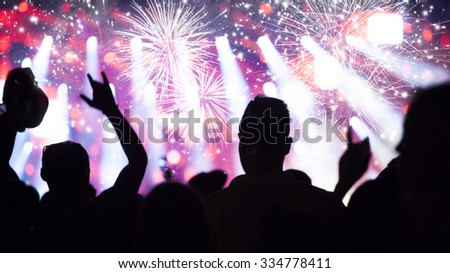 Fireworks and crowd celebrating the New year #334778411