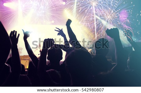 Fireworks and crowd celebrating the New year #542980807