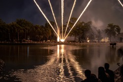 fireworks and laser on a lake