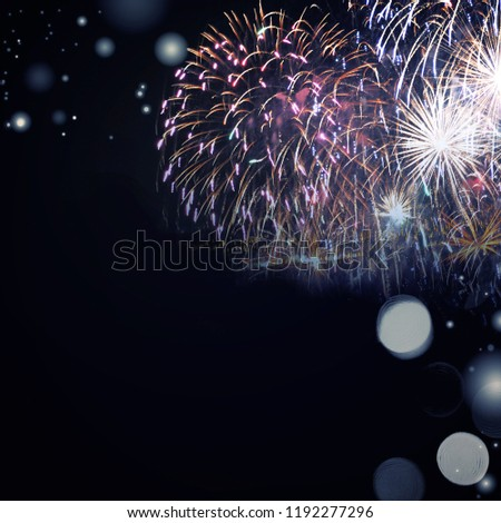 Fireworks at New Year and copy space - abstract holiday background #1192277296