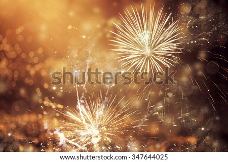 Fireworks at New Year and copy space - abstract holiday background #347644025