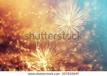 Fireworks at New Year and copy space - abstract holiday background #507810649