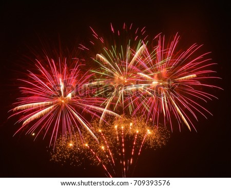Fireworks background. Red fireworks. Happiness concept #709393576