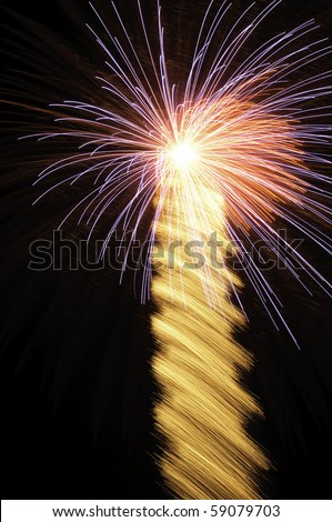 Fireworks beacon: Bright burst with wide, motion-blurred rocket trail #59079703