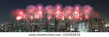 Fireworks celebrating over Tokyo cityscape at night, Japan (panorama) #226466836
