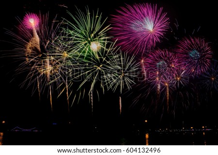 Fireworks Celebration at night on  New Year and copy space - abstract holiday background #604132496