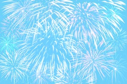 Fireworks celebration on pastel cyan colour background.