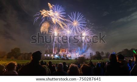 Fireworks display at bonfire 4th of November celebration, Kenilworth Castle, England. #750287641