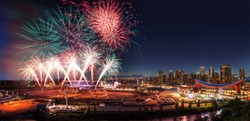 Fireworks display over the night sky with the Calgary downtown skyline in the backdrop during the annual Stampede festivities.
