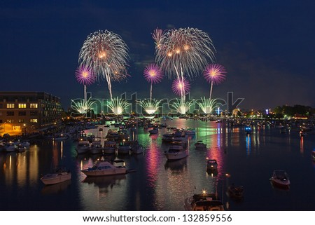 Fireworks explode over the Saginaw River during the 50th anniversary celebration on July fourth in Bay City Michigan, 2012