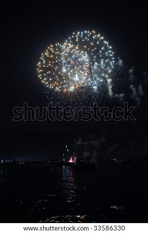 Fireworks exploding over the intracoastal waterway - stock photo