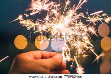 Fireworks in hand Bokeo background blurred #770982466