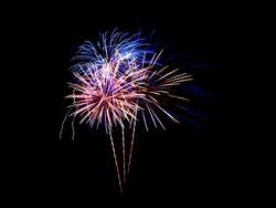 Fireworks light up in the sky, celebration concept.