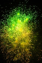 fireworks of various colors green and yellow