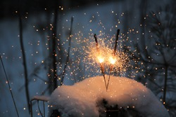 fireworks on a snow-covered stump in the forest