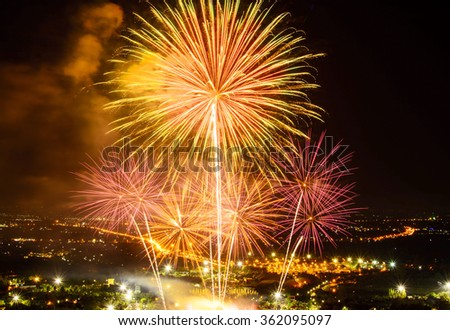 Fireworks on night city background