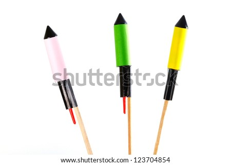 Fireworks on stick isolated over white - stock photo