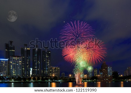 Fireworks over building cityscape, Bangkok Thailand